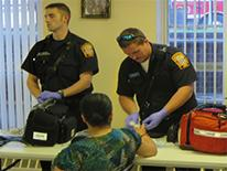Engine 30 team members provide free blood pressure and glucose testing during Thursday's ANC 7C meeting at Sargent Memorial Presbyterian Church