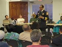F&EMS Chief Kenneth B. Ellerbe outlines the Department's EMS resource redeployment plan to attendees of Wednesday's ANC 4C meeting at the Petworth Library